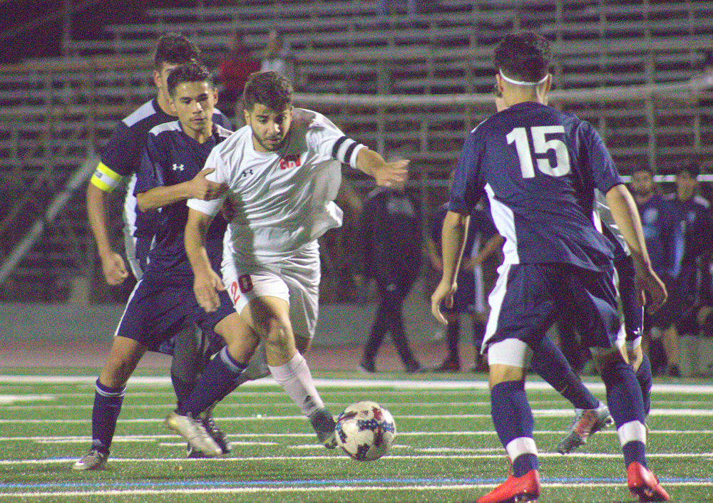 Senior striker and team captain Liyon Kalyana helps lead the El Cajon Valley Braves to a tie against Open Division team Granite Hills during their first conference game of the 2018 season.