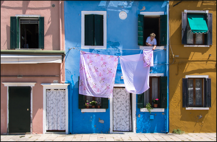 Hanging out the washing by Mike Carroll