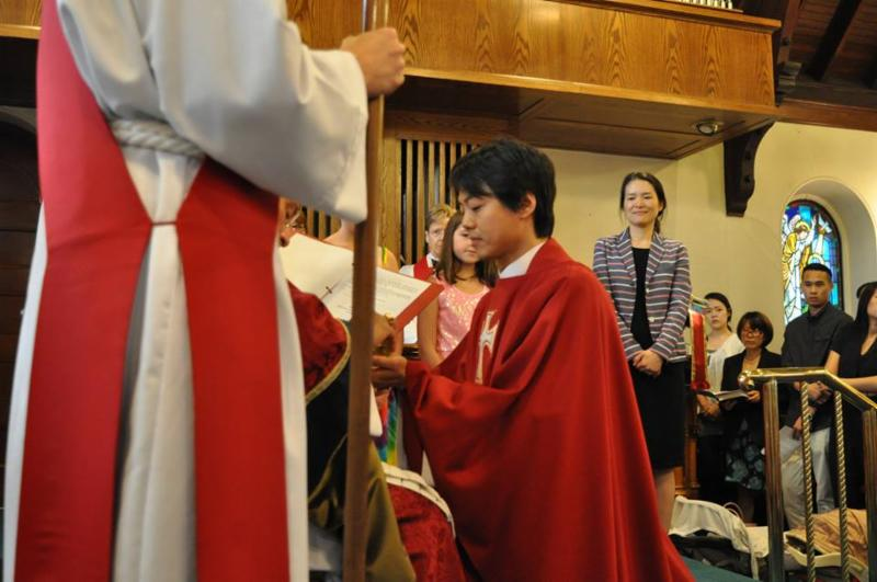 Jae Chung with his wife, Shin, at his side at his ordination to the priesthood on July 19, 2014 photo: St. Ann's Church