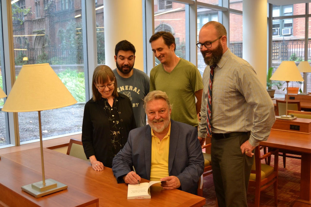"Donn Mitchell '91 signs a copy of ""Tread the City's Streets Again"" at the Christoph Keller, Jr. Library as Prof. Anne Silver '02, Thomas Szczerba and Chris Lee '20, and Academic Dean Michael DeLashmutt look on."