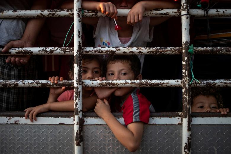 "Credit: Reuters, ""Children of the Caravan."""