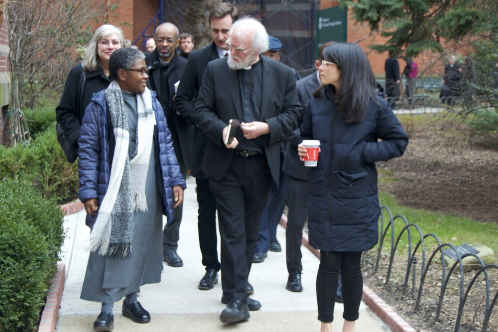 Williams (center) walks to lunch with current students, Sister Promise Atelon (left) and Laura Di Panfilo (right).