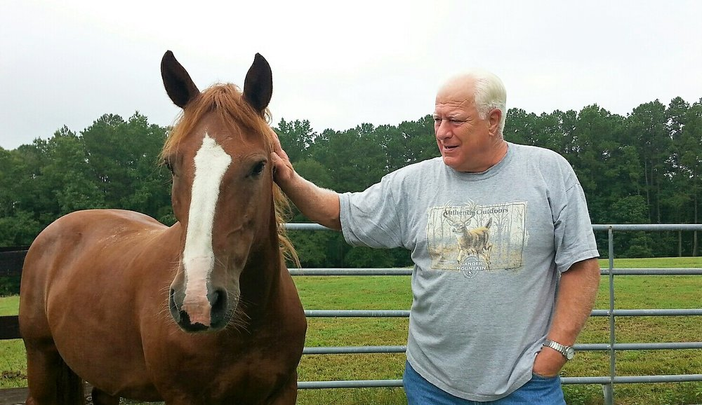 My dad with one of my sister's horses. West End, NC