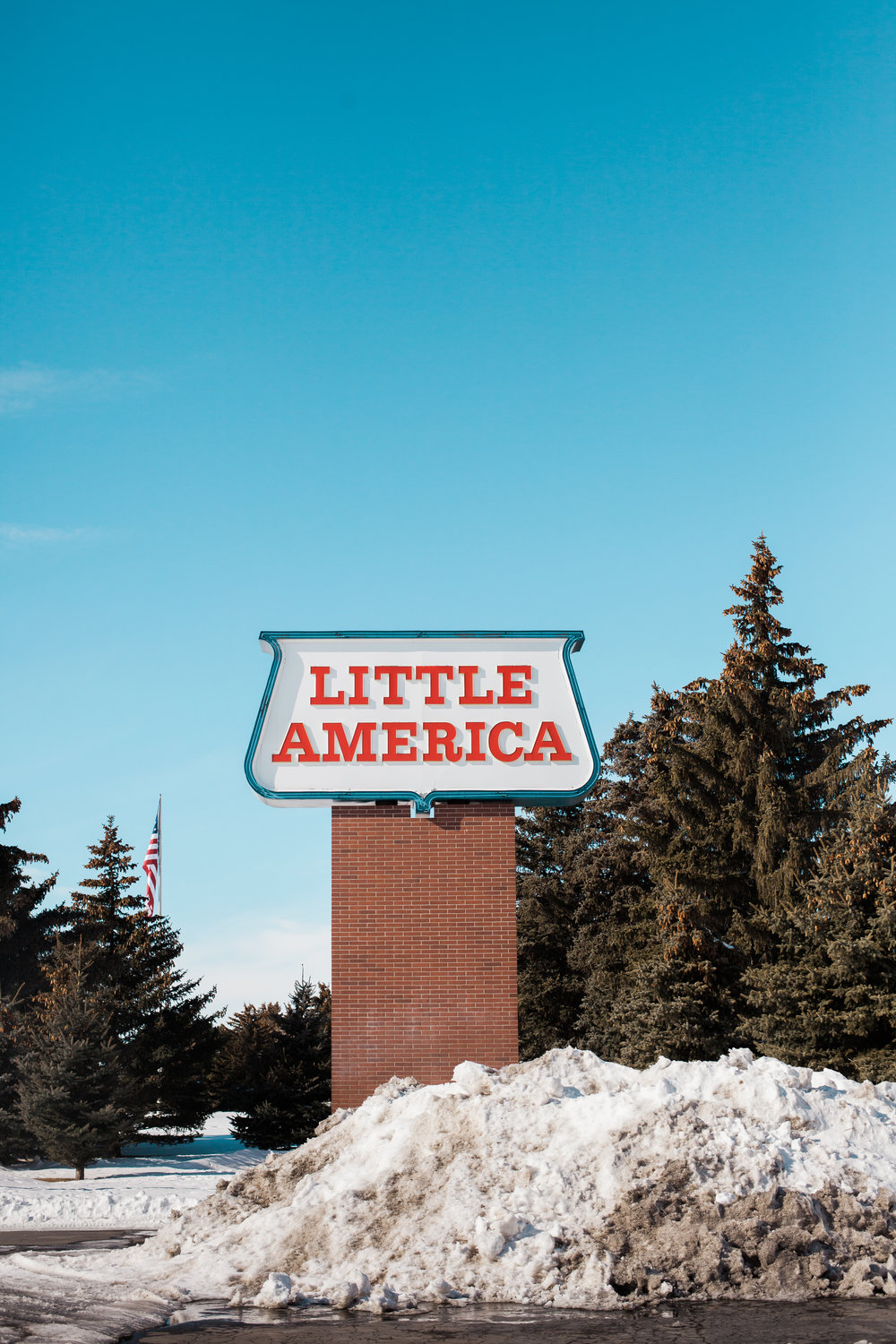 The sign for Little America, a truck stop in Wyoming, where a trucker reminded me of the importance of looking back.