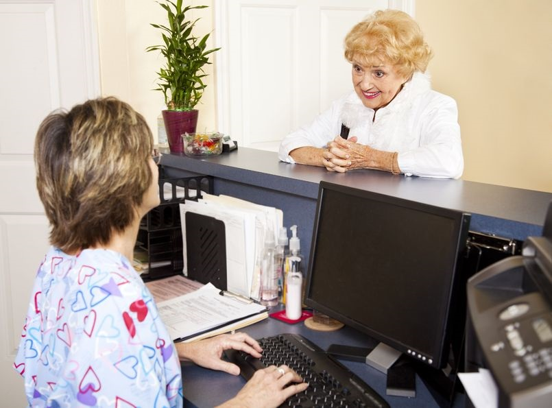 6453339_M_Nurse_Patient_Front Desk_Assistant_receptionist_Doctor's office.jpg