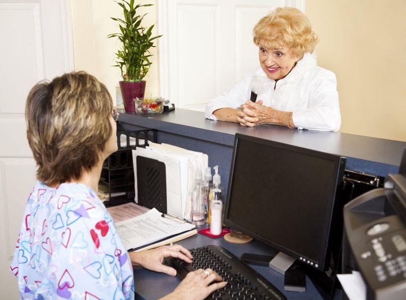 6453339_M_Nurse_Patient_Front Desk_Assistant_receptionist_Doctor's office.jpg