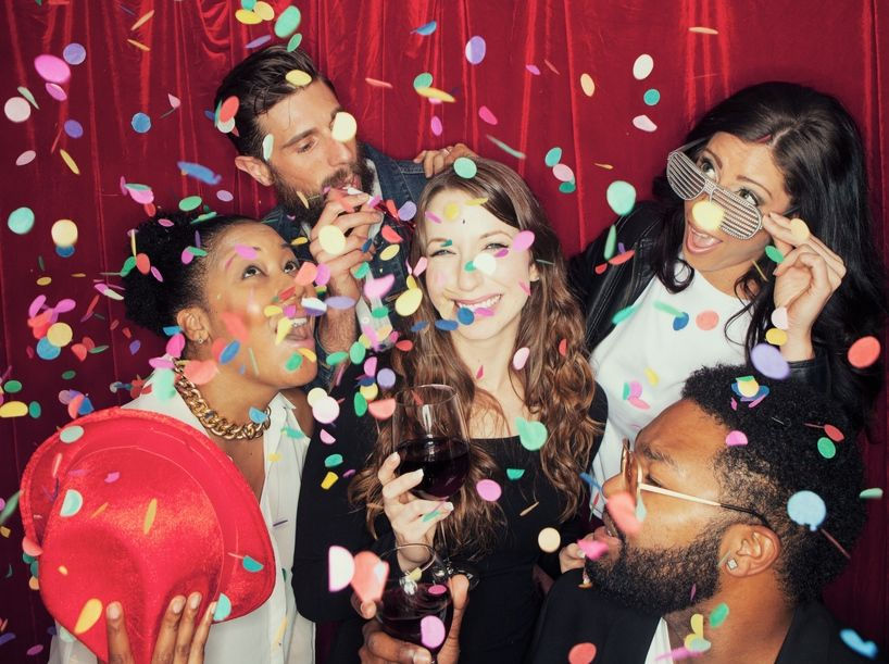 Party-Guests-In-Photo-Booth-At-Event.jpg
