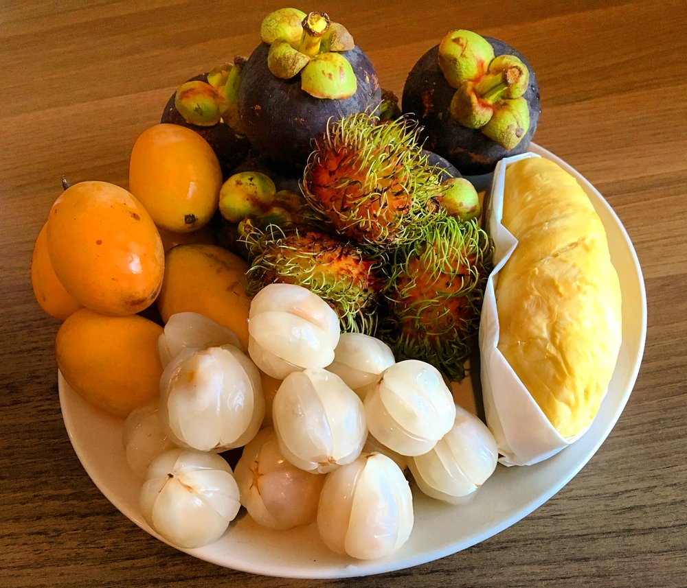 From Top, Clockwise: Mangosteen, Rambutan, Durian, Lanzone, Plum Mango.