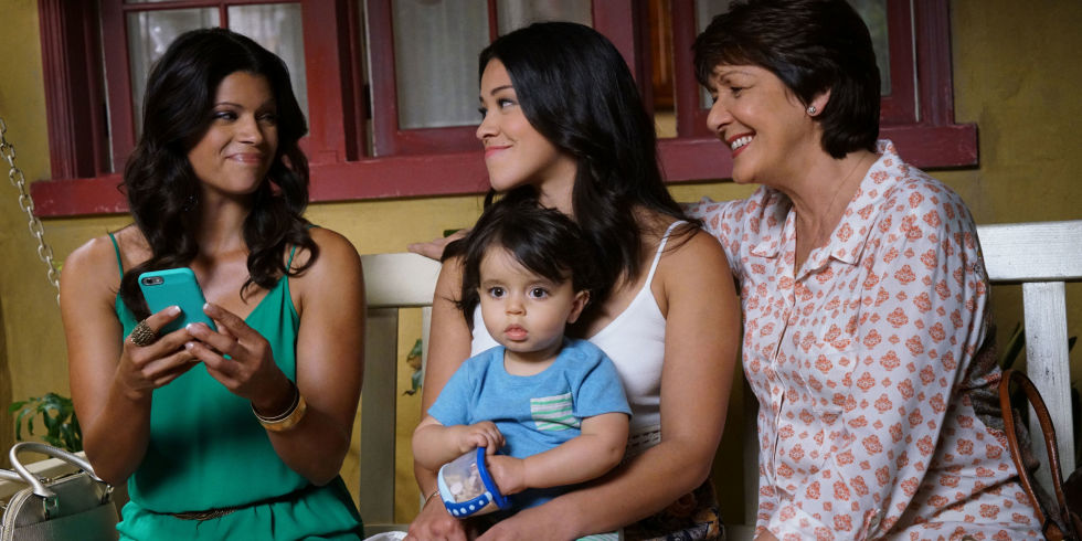 Andrea Navedo as Xiomara, Gina Rodriguez as Jane, and Ivonne Coll as Alba in the The CW series  Jane The Virgin .