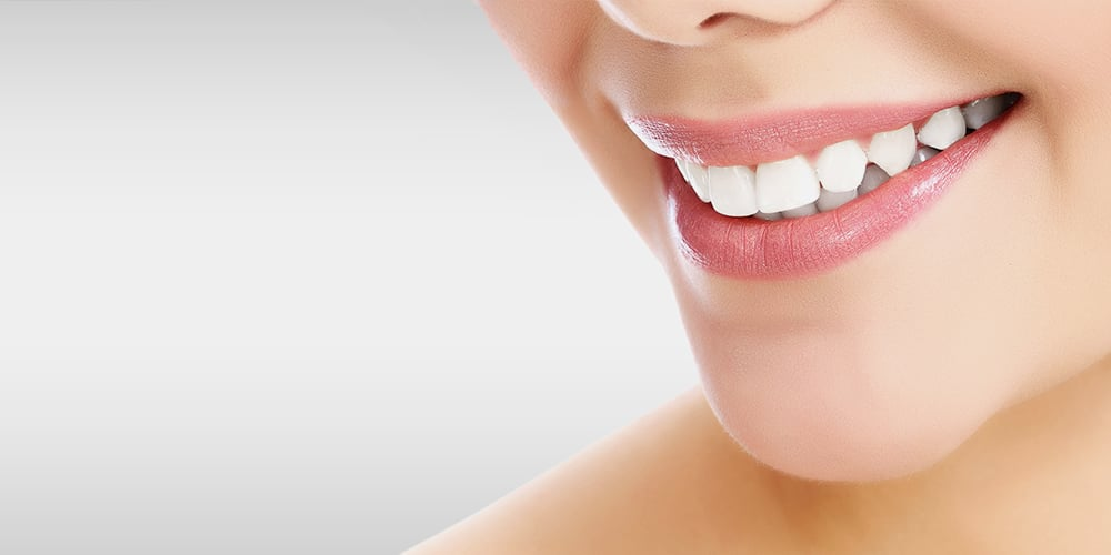 1000x500px-gallery-image(treatments)-cosmetic-teeth-whitening.jpg