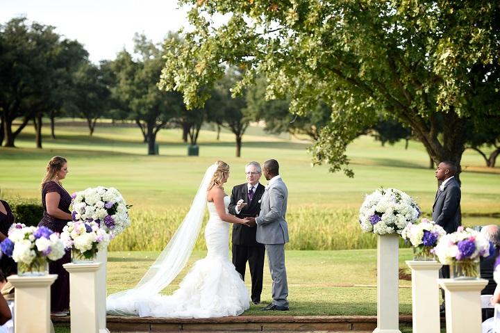 four_seasons_Dallas_Purple_outdoor_wedding_swank_soiree_wedding_planner_alter_bride_groom.jpg