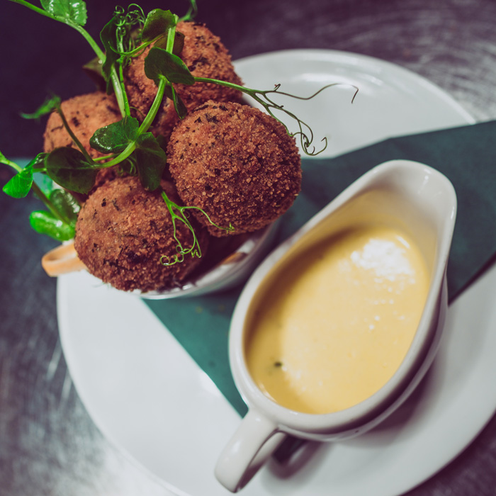 The ultimate bar snacks - Bury black pudding potato cakes from our 'Graze' menu.
