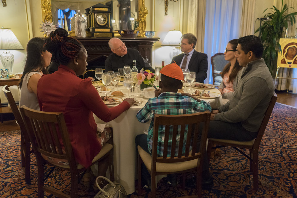 CATHOLIC CHARITIES: Cardinal Dolan invites immigrants to dinner at his home.