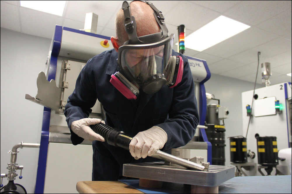 Metal 3D-Printer Operator at Imperial Machine & Tool Co. Removing a Build