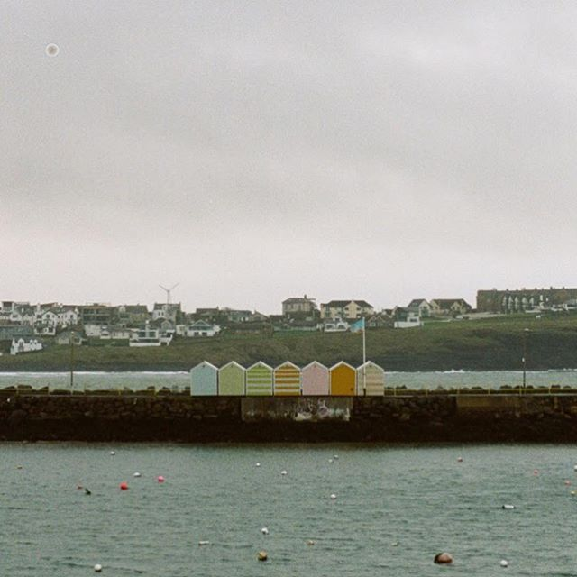 Bathing boxes, Portrush. 35mm Kodak portra 160  #irishphotographer #irishphotography  #bathingboxes #bathingbox #beachhut #beachhuts #portrush #atlanticcoast #coast #harbour #irishatlanticcoast #northernirelandphotography  #northernirelandtourism #35mm #35mmphotography #kodak #kodakportra160 #pentax #pentax35mm  @ramoreportrush @visitportrush