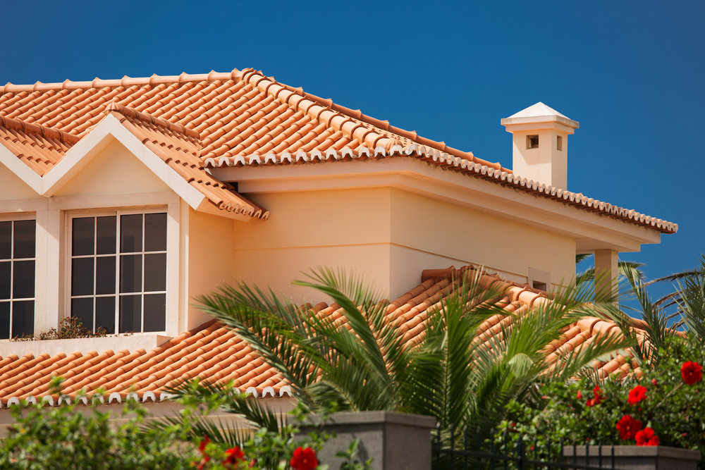 TILE/SLATE - If you want to incorporate natural materials while achieving a major wow factor, a tile/slate roof can give your home personality and tons of curb appeal. ↴