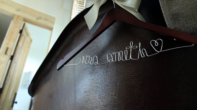 Wedding Video shot of Mrs. Smith coat hanger