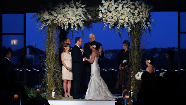 The chuppah was created by Austin florist David Kurio Designs, screen grab from their wedding video