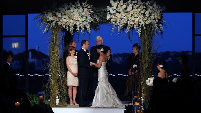 The chuppah was created by Austin florist David Kurio Designs, screen grab from their wedding video