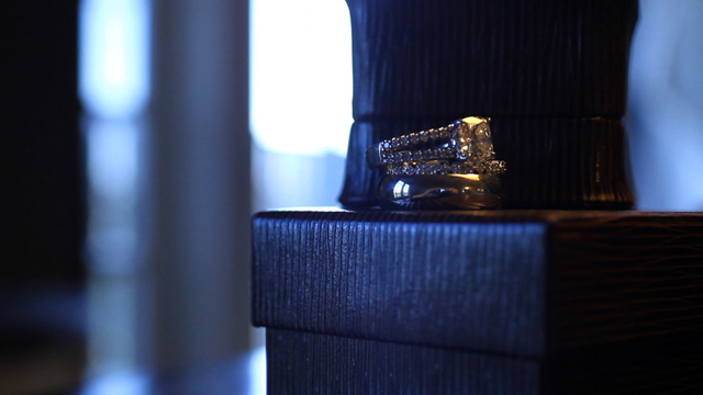 Leslie and Andy's wedding rings screen grab from the wedding video