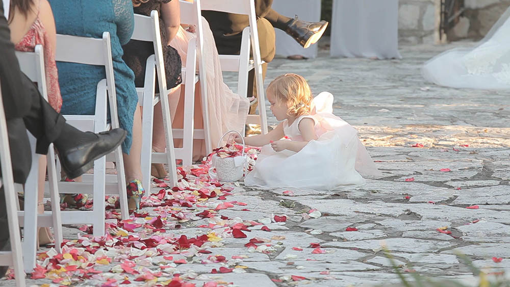cute flower girl during wedding ceremony