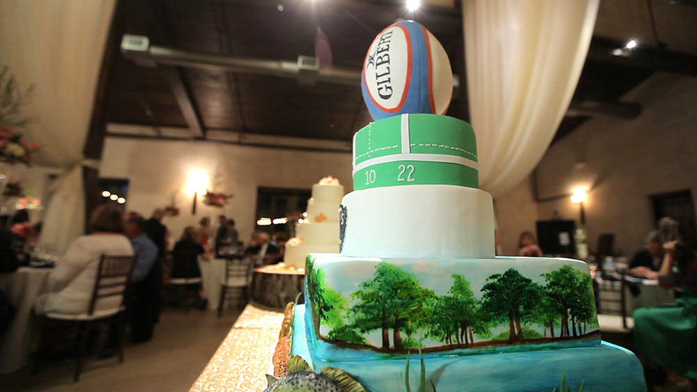 rugby and fishing themed groom's cake at wedding