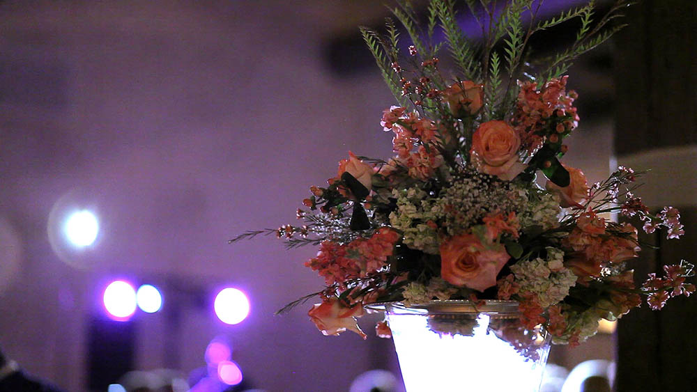 elegant floral arrangement at wedding on top of glass vase