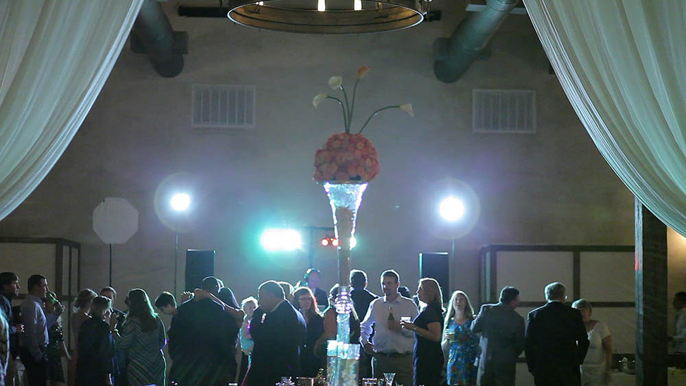 elegant glass floral arrangement at wedding reception