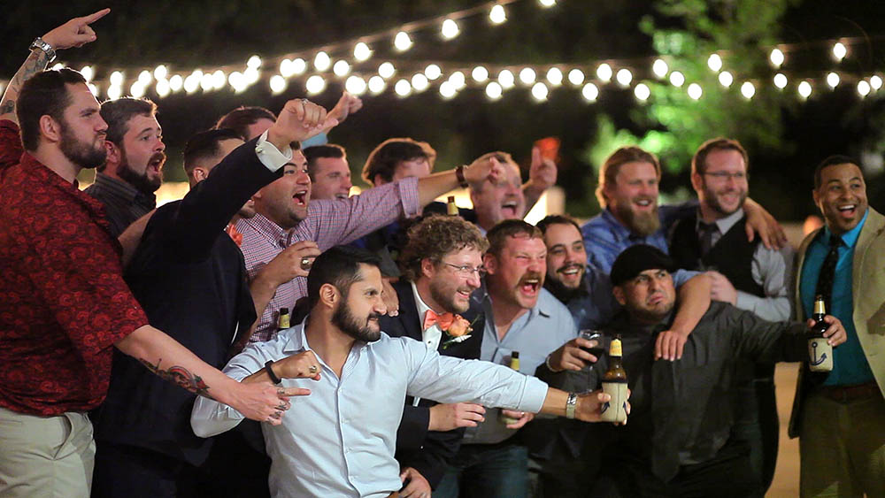 rugby team joins groom at wedding reception