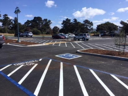 New parking lot with bioswale features and public restroom at the Berkeley Marina.