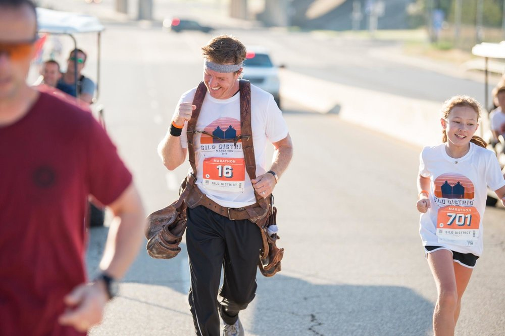 silo-district-marathon-chip-gaines-running-with-daughter-toolbelt-waco.jpg