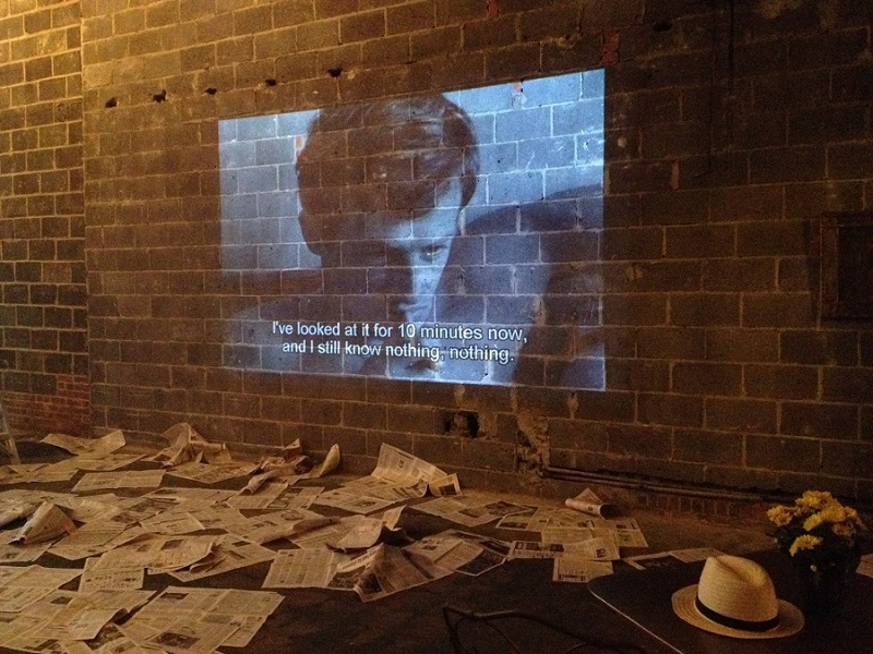 A BREATHLESS EVENING  |    Saunders + Hall    Lorrie Sauders and Brad Hall give a nod to French New Wave Cool with an Installation in Vacant Storefront  .  June 25, 2015  .  Downtown Norfolk, VA