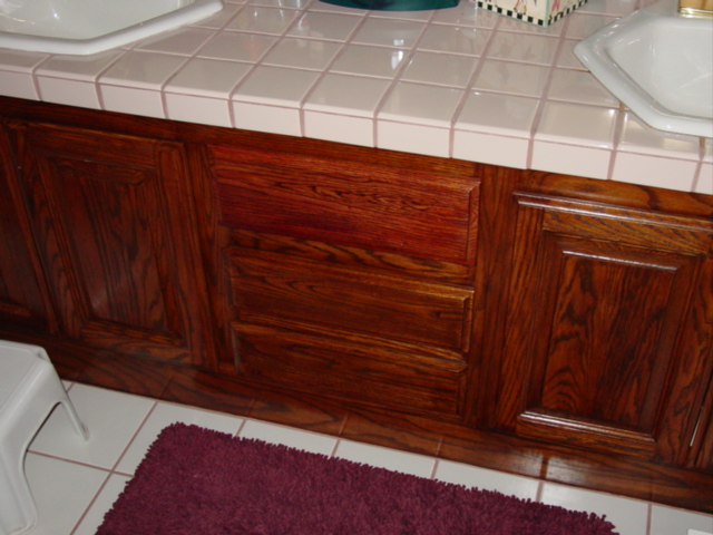 Dark_mahogany_stained_cabinets.jpg