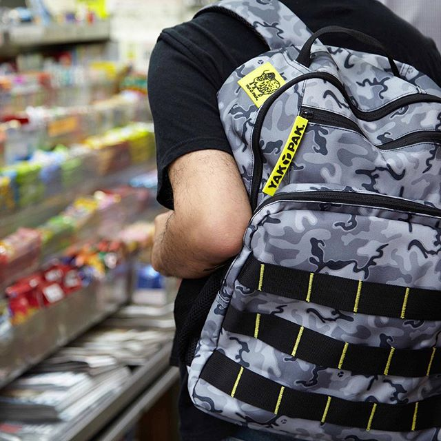 Gray, rainy Monday's call for an extra candy stop at the corner stand. 🍫 P.S. This gray camo backpack is available now @minnowandmars. #mondays #yakpaksback