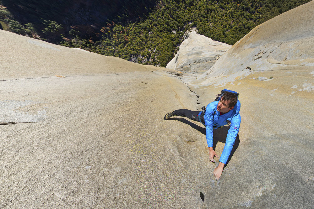 Alex Honnold on the Pankcake Flake.  A granite flake as thin as a pancake was formed when the left side of the wall overlaps the right, creating perfect handholds.    Explore here in 360.