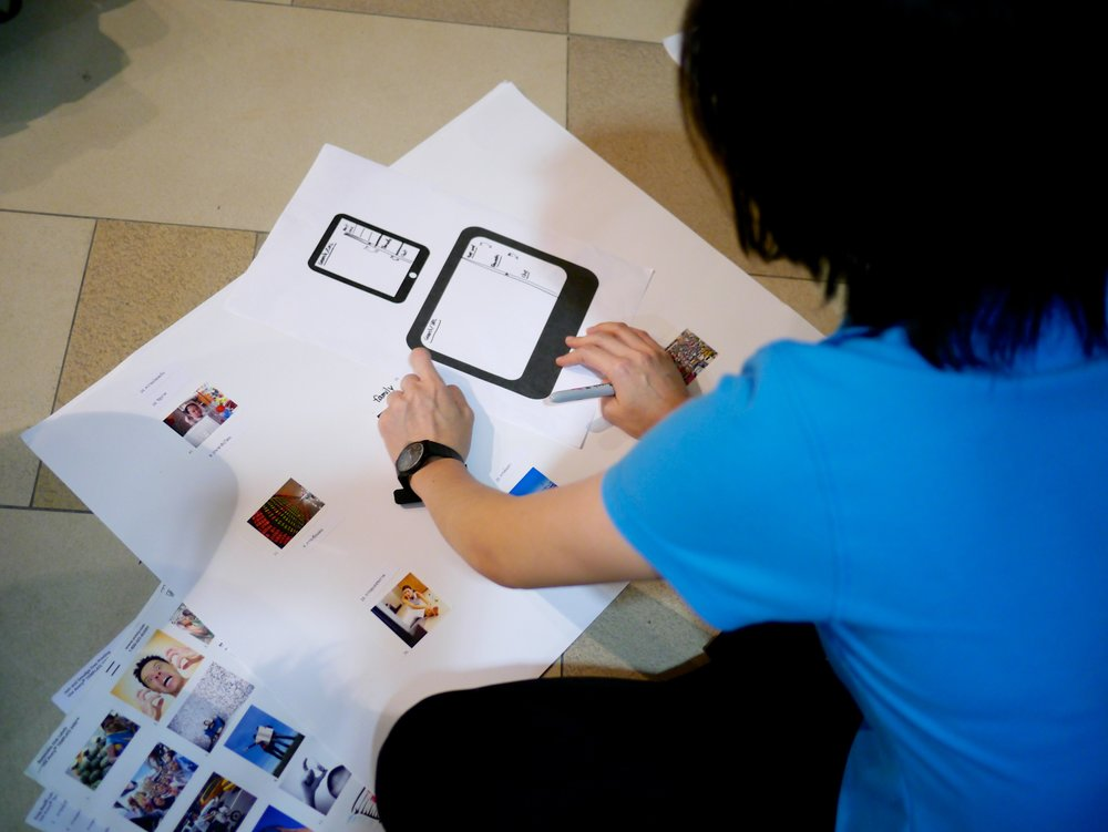 """Bangkok participant engaged in an """"Ideal Browser"""" participatory design exercise (August 2013)"""