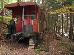 29,900 - Acreage +/-: 1.8Unique!Little Red Caboose On The River