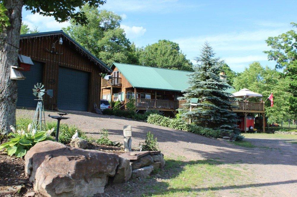 359,900 - Beautiful Log Home!3 Bedrooms, 3 Baths35.40 AcresLarge Pond & Views!