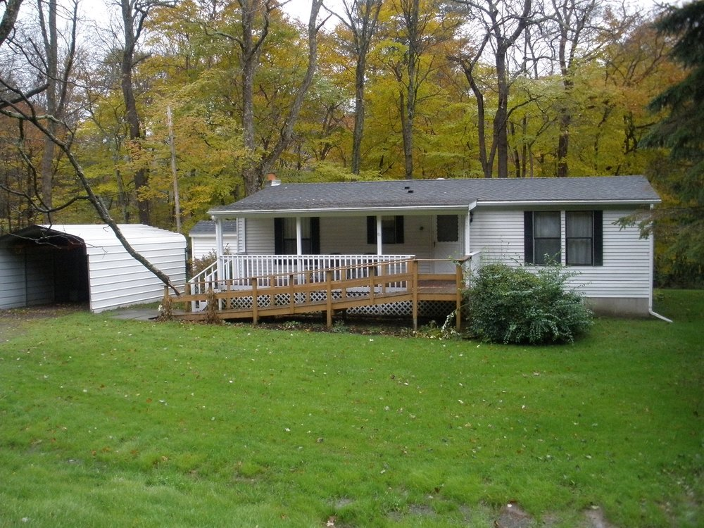 80,000 - 2 Bedrooms, 2 Baths1/3 AcreHandicap AccessibleOff Quaint Country Road