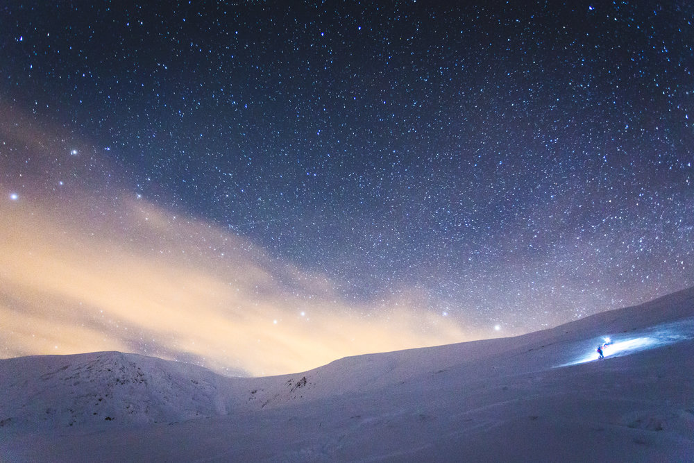 Making slow progress through deep snow, beneath the stars