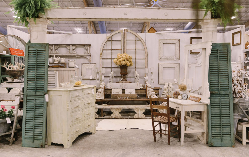 Booth featuring vintage pieces at the City Farmhouse Pop Up Fair in Louisiana