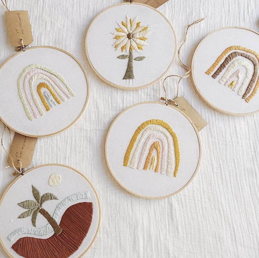 Woven Love     www.wovenlovestore.bigcartel.com    Sunshine Coast's  Woven Love  hand make embroidered hoops featuring rainbows, palm trees, moons and more.