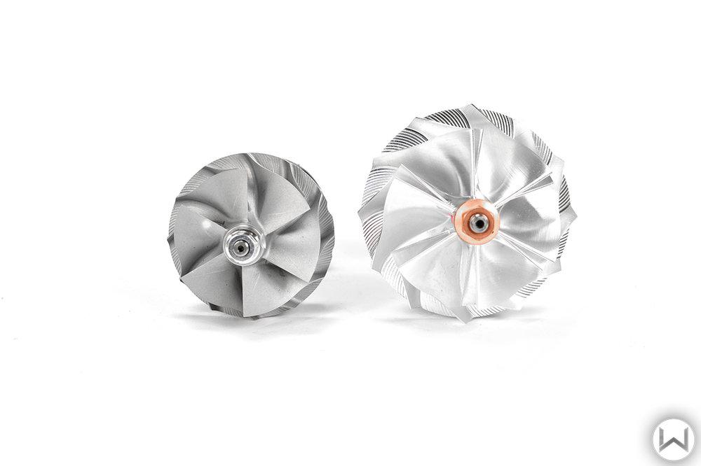 OEM compressor wheel left vs. 27WON Billet Upgraded compressor wheel on the right