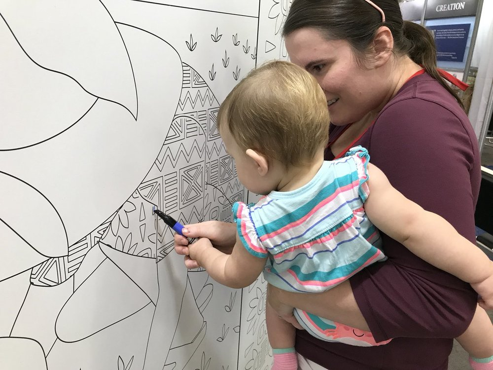Lydia and Mom coloring at the Episcopal Relief and Development booth. Photo courtesy of @seanmcconnell on Twitter.