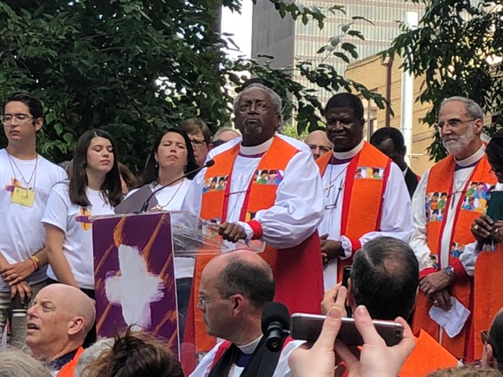 Presiding Bishop Michael Curry standing among the Bishops United Against Gun Violence. Picture credit to Episcopal News Service.