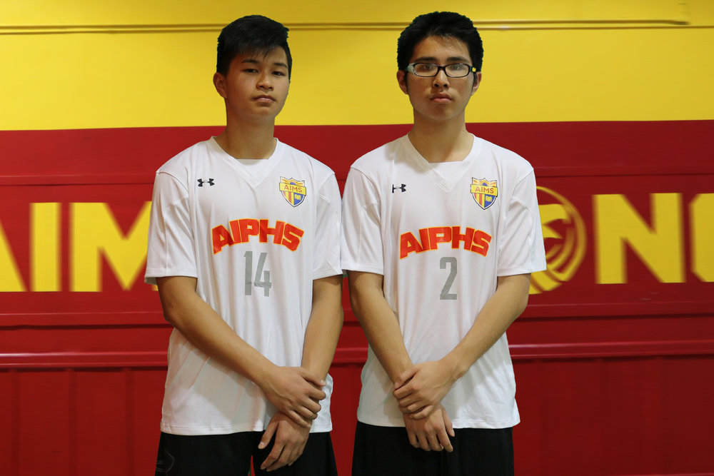 Andy Phan (#14) and Henry Huang (#2) were among those who practiced independently of an official AIPHS Boys Volleyball Team.