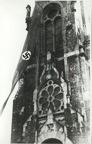 Nazi banner flies in front of a church in Sucha, a town annexed from Poland.