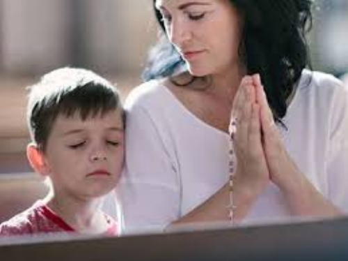 Mother teaching prayer.jpg