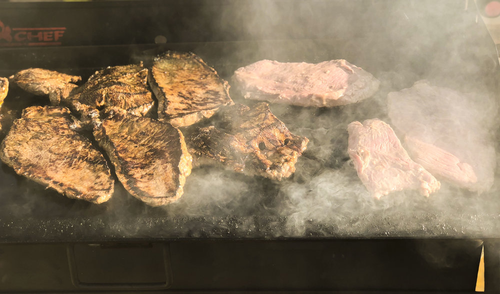"""Carne Asada should be cooked simply with lime, salt, and """"the """"breath of the fire""""."""