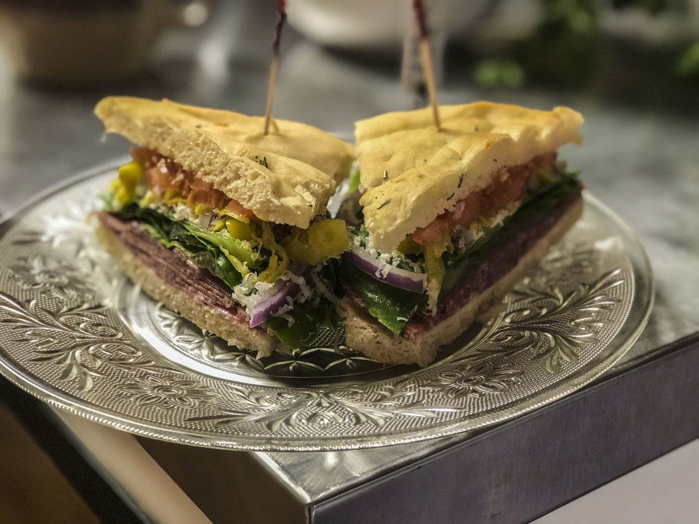 Now, I may be partial, but I'm pretty sure this Focaccia bread italian sandwich with shaved romano cheese will contend with the best of them.